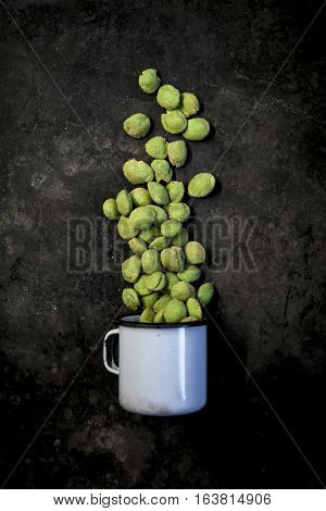 Wasabi Peanuts On Black Background