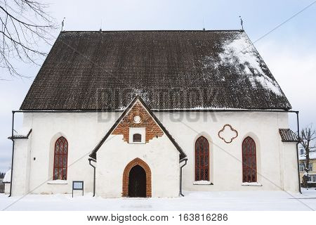 Small ancient white church in the old town of Porvoo Finland in snowy winter day