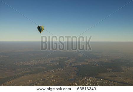 Air balloon in the sky over autumn fields