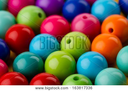 close up of many colored glass pearls beads texture