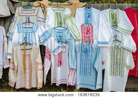 Traditional Ukrainian national clothes with embroidery outdoors.