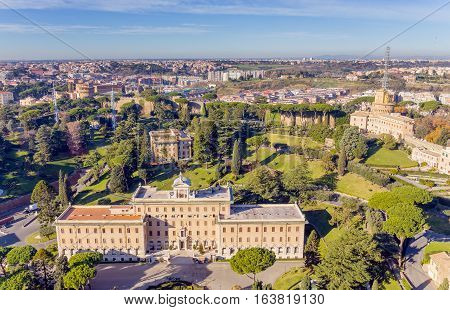 View at the Vatican Gardens and the Palace of the Governorate in Rome from the dome of St. Peter's basilica.