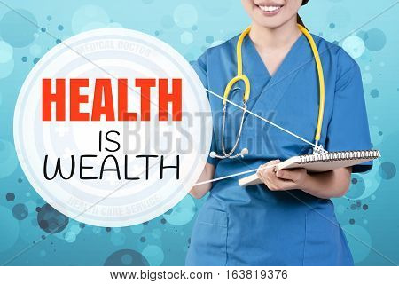 Smile Female Doctor With Blurry Blue Glitter Point To Text: Health Is Wealth