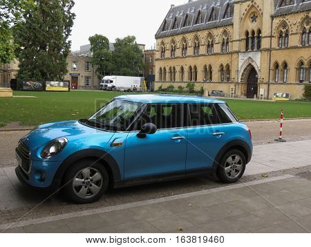 Light Blue Mini Cooper Car In Oxford