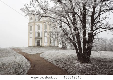 Chapel of St. Florian in winter fog. Moravsky Krumlov Czech Republic