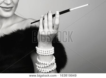 The Mouthpiece Is In The Hands Of Gorgeous Woman, A Beautiful Woman Smokes While