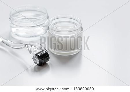 concept beautician desktop with mezoroller - mesotherapy on white background.