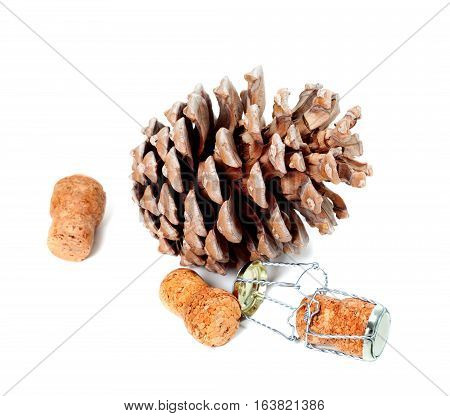 Big pine cone and champagne wine corks with muselet. Isolated on white background.