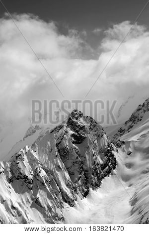 Black And White View On Snow Mountains In Cloud
