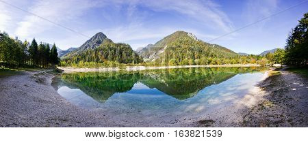Bohinj lake and mountains. Panorama of wild landscape natural environment. Panorama of hills. Julian Alps