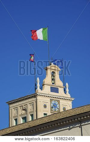 'Tower of the Winds' Quirinal Hill renaissance clock tower with Italian national flag built in the 16th century