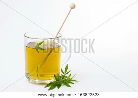 Cannabis Herbal Tea And Marijuana Leaves