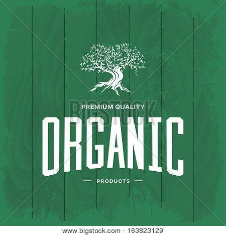 Olive tree vintage logo concept isolated on green wooden background. Web infographic organic product retro pictogram. Premium quality grunge threadbare wood texture illustration mockup.