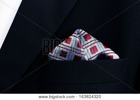 pocket square - handkerchief in the breast pocket of a man's wool suit