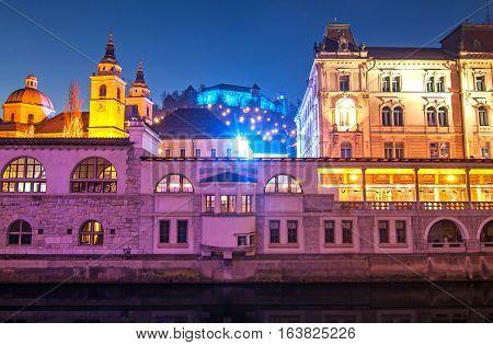 St. Nicholas cathedral and Ljubljanas castle illuminated for New Years celebration