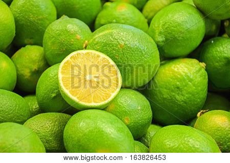 slice fresh lime and many limes for sales at market