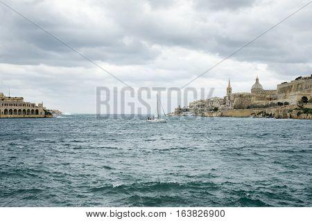 Sail boat navigating at Marsamxett Harbor Malta