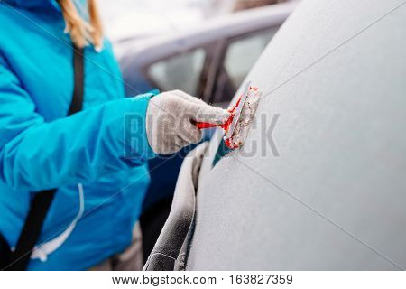 Woman Deicing Rear Car Windshield