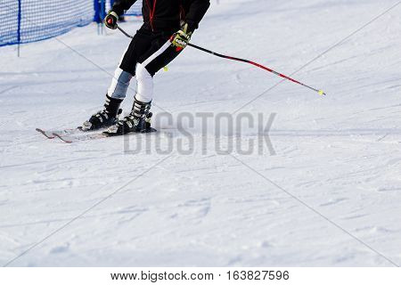 Man skier riding down the at the mountains