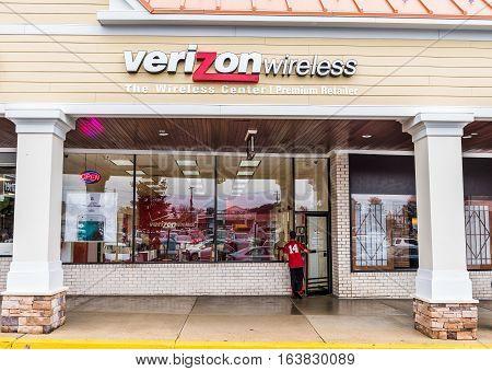 Fairfax, USA - November 30, 2016: Verizon wireless center store facade exterior with person entering