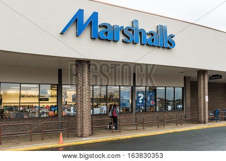 Fairfax, USA - November 30, 2016: Marshalls storefront with blue sign and people walking by entrance of store