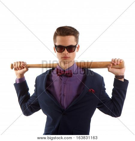 A teen male in a suit holding a baseball bat