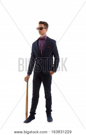 A young adult in wormal wear with a baseball bat