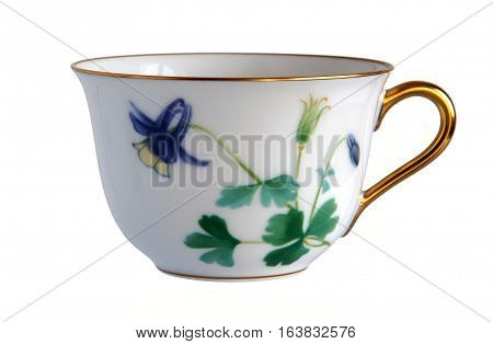 An antique porcelain cup Flowers of Aquilegia isolated on white background
