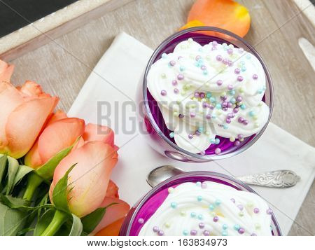 Colorful jelly with whipped cream and candy topping