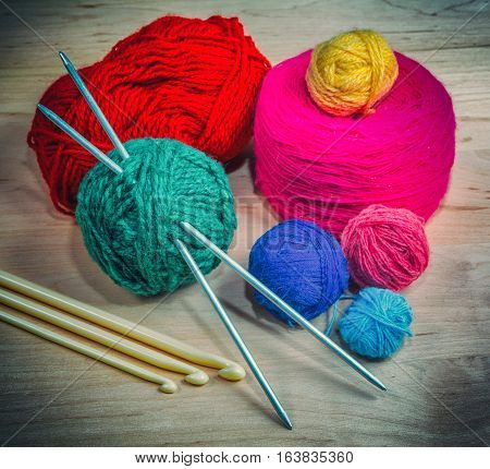 colorful knitted wool colored balls for knitting in the basket retro style