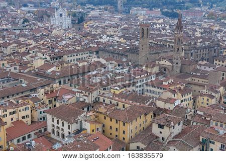Red roofs of old houses Florence seen from the observation platform of Campanile di Giotto. Florence is the ancient capital city of the Italian region of Tuscany, Metropolitan City of Florence.
