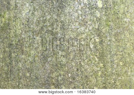 Closeup image of some weathered granite on a statue, suitable for backgrounds
