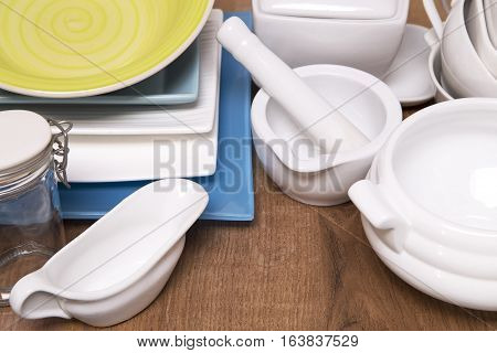 Various porcelain dishes on brown wooden background