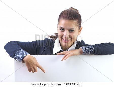advertising banner sign - woman excited pointing on empty blank billboard paper sign board. Young business woman isolated on white background.