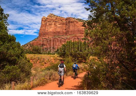Bikers head toward Courthouse Butte in Sedona, AZ
