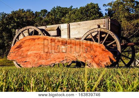 Farm wagon with red glazed slab or plank of wood