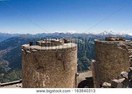 Ruined italian artillery turret on top of Mont Chaberton with Alps panorama.