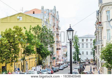 Kiev, Ukraine - June 6, 2013: Andriyivskyy Uzvoz Descent or Spusk with architecture and people walking