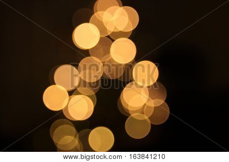 Blurred golden background lights during christmass holidays