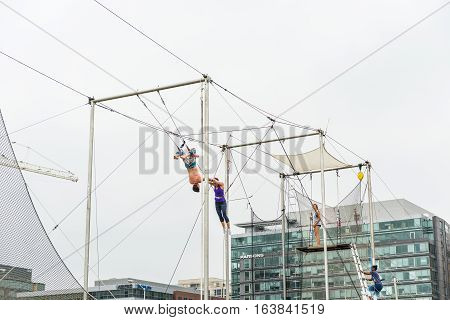 Washington DC USA - September 24 2016: Trapeze artists training outside in park