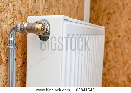 supply to the radiator in the bathroom close up