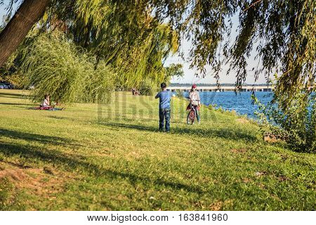 Washington DC, USA - September 25 2016: Asian couple with bicycle taking pictures in West Potomac park by river