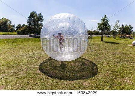 Child Has Fun In The Zorbing Ball