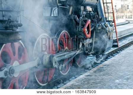 Retro steam train departs from the railway station