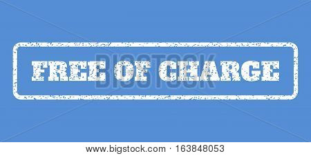 White rubber seal stamp with Free Of Charge text. Vector tag inside rounded rectangular frame. Grunge design and dirty texture for watermark labels. Horisontal emblem on a blue background.