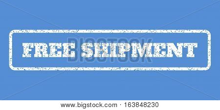 White rubber seal stamp with Free Shipment text. Vector tag inside rounded rectangular shape. Grunge design and scratched texture for watermark labels. Horisontal sticker on a blue background.