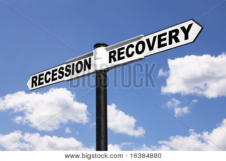 Signpost with the words Recession and Recovery against a blue cloudy sky