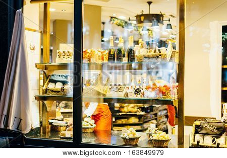 STRASBOURG FRANCE - DEC 20 2016: Paul Boulangerie Et Patisserie cafe with window shopping full of pastries sweets and champagne. Paul is a French chain of bakery/cafe restaurants established in 1889 in the city of Croix in Northern France