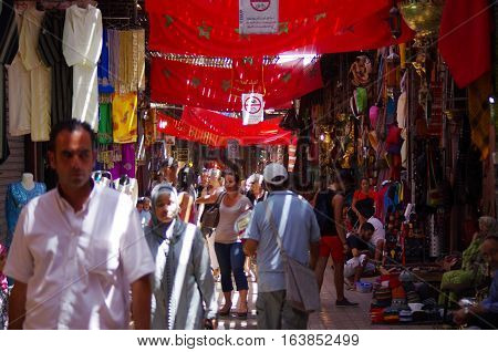 Tourists In The Alleys Of The Souk Of Marrakech.