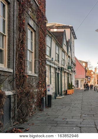 Bury St Edmunds, UK. 26th December 2016. The streets of Bury St Edmunds at Angel Hill by the Abbey Gardens are quiet on a Boxing day late afternoon. A few people are walking along the road.